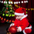 Kid playing with Christmas ball — Stock Photo