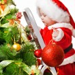 Toddler with a Christmas ball — Stock Photo
