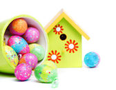 Easter eggs and birdhouse — Stock Photo