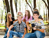 Teens crowd in park — Stock Photo
