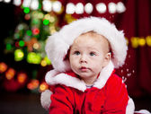 Baby in large Christmas hat — Stock Photo
