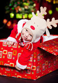 Baby in a present box — Stock Photo