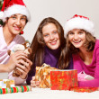 Teenagers packing Christmas gifts - Stok fotoğraf