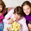 Teens eating crisps — Stock Photo #8685950