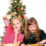 Girls making cookies — Stock Photo