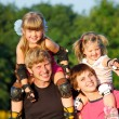 Happy parents with kids — Stockfoto