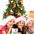 A snowman and three kids — Stock Photo #8686527