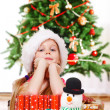 Girl beside presents — Stock Photo #8686552