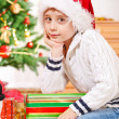 Kid beside presents — Stock Photo #8686555