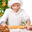 Kid rolling dough — Stockfoto
