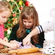 Children cutting Christmas cookies — Stock fotografie