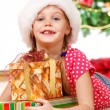 Girl embracing Christmas presents — Stok fotoğraf