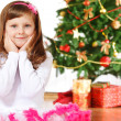 Girl beside Christmas tree — Stock fotografie