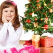 Girl beside Christmas tree — Stok fotoğraf