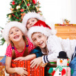 Stock Photo: Kids fighting for presents