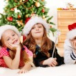 Kids in Santa hats — Stock Photo