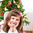 图库照片: Child in front of a Christmas tree