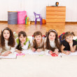 Junior students drawling - Stock Photo