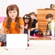 Kid in front of laptop — Stock Photo