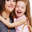Stock Photo: Girl embracing mother