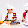 Brother and sister cooking — Stock Photo