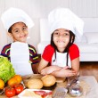 Cute african american little cooks — Stock Photo
