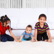 Brothers and a sister crawling — Stock Photo