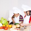 Boy and girl cooking - Stok fotoğraf
