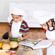 Stock Photo: Kids making salad