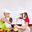 Stock Photo: Siblings making sandwich