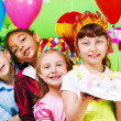 Kids group in party crowns — Stock Photo