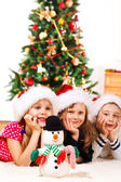 A snowman and three kids — Stock Photo