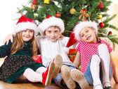 Friends under Christmas tree — Stock Photo