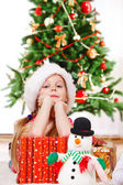 Girl beside presents — Stock Photo
