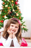 Child in front of a Christmas tree — Stock Photo