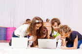 Girls playing computer games — Stock Photo