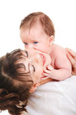 Baby kissing mother — Stock Photo