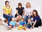 Young women and kids — Stock Photo