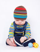 Baby boy in bright clothing — Stock Photo