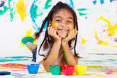 Kid playing with finger paints — Stock Photo