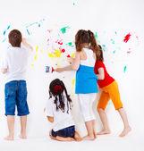 Kids painting wall — Stock Photo