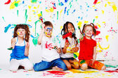 Kids with paintbrushes — Stock Photo