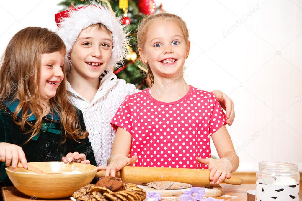 Three smiling kids cooking — Stock Photo #8686494