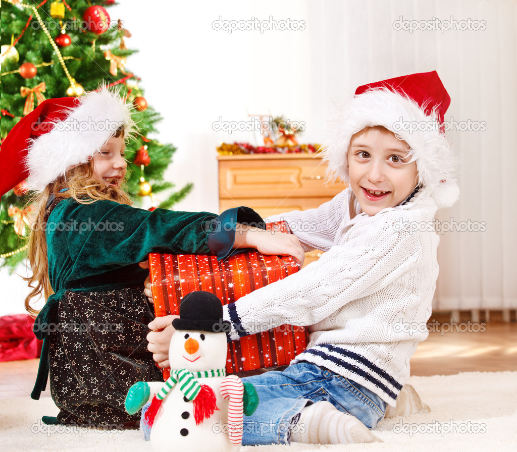 Girl and boy fighting for present  Photo #8686640