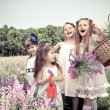 Girls  holding flower baskets — Stock Photo