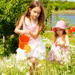 Sisters in the garden - Stock Photo