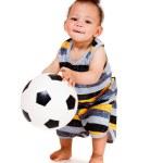 Baby holding ball — Stock Photo