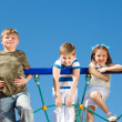Stock Photo: Friends climbing net