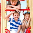 Stock Photo: Boys and girl on playground