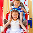 Children on the chute — Stock Photo